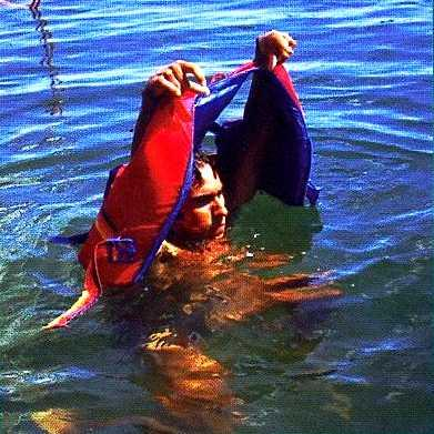 The technique for putting on a PFD while in the water